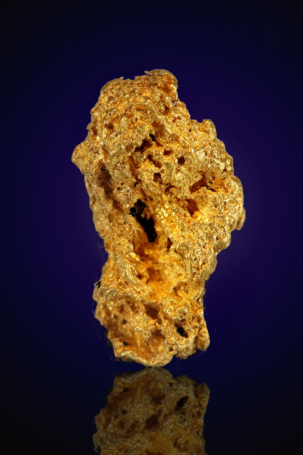Heavily textured elongated gold nugget from Nevada